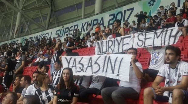 Authorities in Turkey let fans with knives go free but order fans with a banner to be arrested