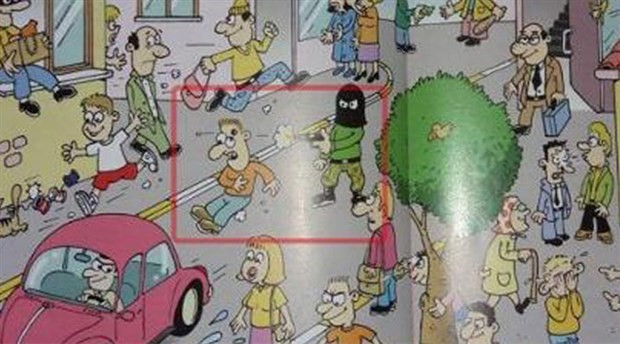 İlkokul kitabında silahla kafaya ateş eden maskeli şahıs görseli!