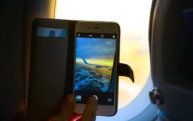 Uçakta cep telefonunu kapatmayanlara 2 bin 124 TL ceza