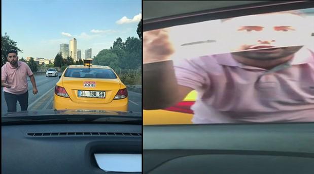 Yol kesip, tehdit eden taksici kamerada