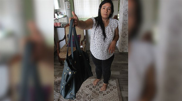 Boşanmak istediği erkeğe attığı çanta, 'silah' sayıldı