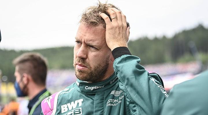 Formula 1 pilotu Sebastian Vettel, yarış sonrası görevlilerin çöp toplamasına yardım etti