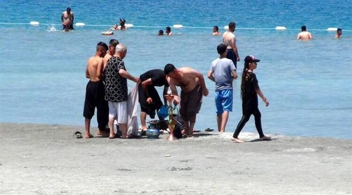 Salda Gölü'nde nargile içip çamur banyosu yaptılar, plaja rögar kapağı attılar