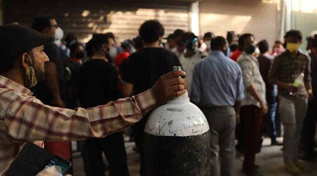 hindistan-da-covid-19-salgini-felaket-boyutunda-krematoryumlarda-yer-kalmadi-oluler-sokaklarda-yakiliyor-869879-1.