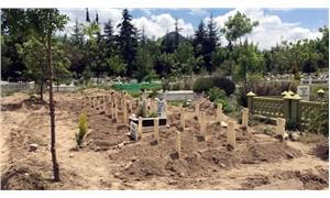 Kamulaştırma bedeli ödenmeyen arazisindeki mezarları kaldırttı
