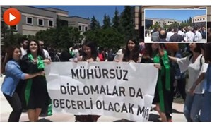 Security in Turkey take away banner that read 'Will unstamped diplomas be valid, too?'