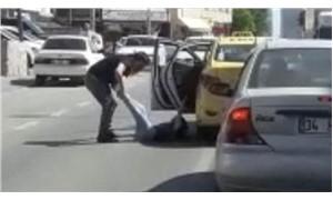Kadın yolcuyu bacağından tutup dışarı atan taksici yakalandı
