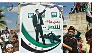 İdlib'te gösteri düzenleyen cihatçılar, Rus elçiyi öldüren FETÖ'cü polisin pankartını taşıdı