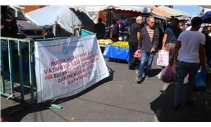 Müşteriye kaba davranan pazarcıya şaşırtan ceza: Pankartla duyuruldu
