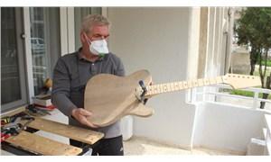 Karantina günlerinde balkona atölye kurdu, gitar yapımına başladı: 'Adını korona koyacağım'