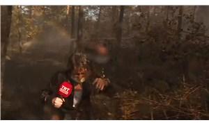 Yangını canlı yayında anlatan haber ekibi helikopterden boşalan suyun altında kaldı