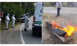 Kütahya'da koronavirüsten ölen kişinin tabutu yakıldı