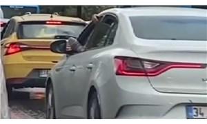Ayağını camdan uzatarak araba süren adama 288 lira ceza kesildi